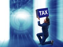 The man under the burden of tax payments Stock Photo