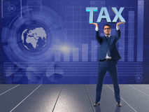 The man under the burden of tax payments Stock Images