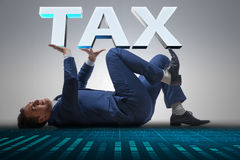 The man under the burden of tax payments Royalty Free Stock Photos