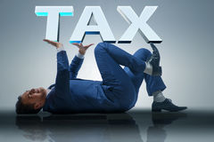 The man under the burden of tax payments Royalty Free Stock Image