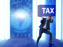 The man under the burden of tax payments Stock Image
