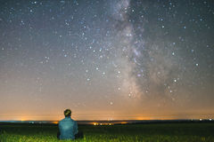 Man under the center of our home galaxy, the Milky Way galaxy, night stars landscape stock images