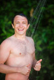 Man under a cold shower Royalty Free Stock Images