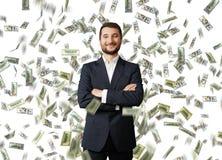 Man under dollar's rain Stock Images