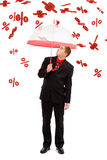 Man under falling percents. Business man with umbrella, under falling big percents signs Stock Photo