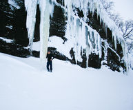 Man under gigantic icicles Stock Images