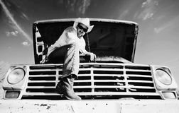 Man under the hood of his truck Royalty Free Stock Images