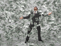 Man under the money rain Royalty Free Stock Photos