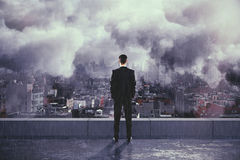Man under the rain and clouds on the top of building Royalty Free Stock Photos