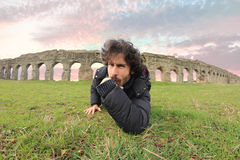 Man under the roman acqueducts Stock Photography
