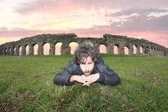 Man under the roman acqueducts Stock Photos