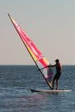 Man under sail. Man, sail and sea Royalty Free Stock Image