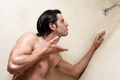 Man under the shower Royalty Free Stock Photo