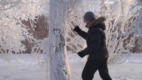 Man under the snow. Slow motion stock footage