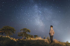 Man under stars of Milky Way Galaxy Stock Images