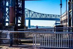 man standing under bridge stock image