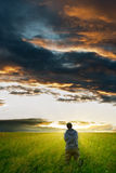 Man under the storm clouds royalty free stock photography