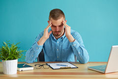 Man under stress. Young business man under stress with headache and migraine Royalty Free Stock Image