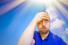 Man under sun rays stock image