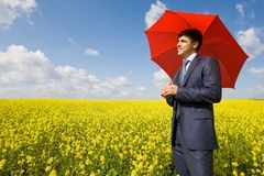 Man under umbrella Stock Photos