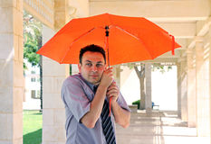 Man under an umbrella Stock Image