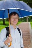 Man under umbrella Stock Image