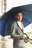 Man under an umbrella Royalty Free Stock Image