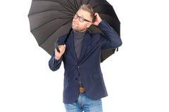 Man under umbrella Stock Image
