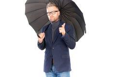 Man under umbrella Stock Photography