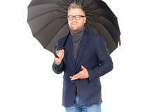 Man under umbrella Stock Images