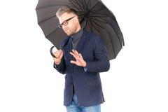 Man under umbrella Stock Photo