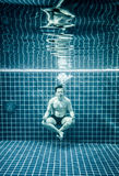 Man under water in a swimming pool to relax in the Stock Photography