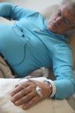 Man undergoing chemotherapy Stock Photo