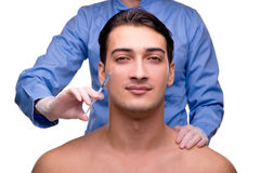 The man undergoing plastic surgery isolated on white Stock Image