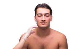 The man undergoing plastic surgery isolated on white Royalty Free Stock Image