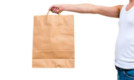 Man in undershirt holding a paper bag Royalty Free Stock Photography