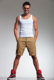 Man in undershirt and shorts smiling Stock Photo
