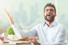 Man understood a simple thing. Handsome young businessman at workplace just understood a simple thing stock image
