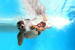 Man underwater with tablet PC Stock Photo