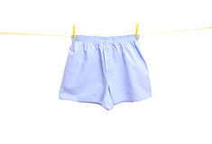 Man underwear on clothes line. Blue man underwear on clothes line stock photo