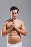 Man in underwear prayer position Royalty Free Stock Photography