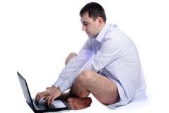 man undressed working royaltyfri foto