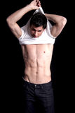 Man Undressing. Man removing his t shirt Royalty Free Stock Images