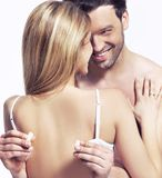 Man is unfastening the bra Stock Photo
