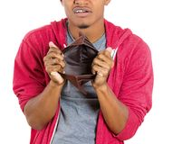 Man unhappy about his empty wallet Royalty Free Stock Images