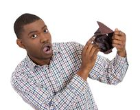 Man unhappy about his empty wallet Royalty Free Stock Photography