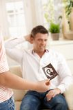 Man unhappy about pregnancy Royalty Free Stock Image