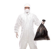 A man in uniform holding a black garbage bag Stock Photography