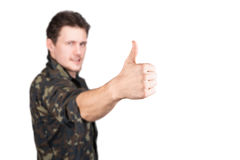 Man in uniform shows OK sign Stock Images