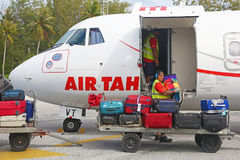 Man unloading baggages from Air Tahiti airplane. Bora Bora, French Polynesia - August 14, 2017: Man unloading baggages from Air Tahiti airplane Stock Photos